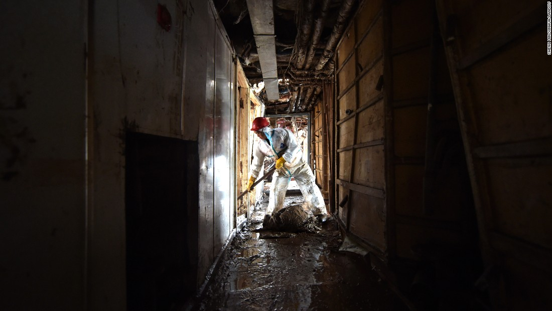 A worker clears a hallway of the ship on June 8.