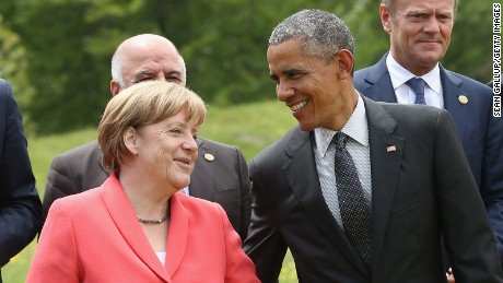 German Chancellor Angela Merkel and U.S. President Barack Obama chat during the outreach group photo on the second day of the summit of G7 nations at Schloss Elmau on June 8, 2015, near Garmisch-Partenkirchen, Germany.