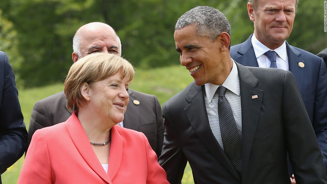 Merkel and Obama chat while posing for a group photo on Monday, June 8, the second day of the summit of G7 nations.