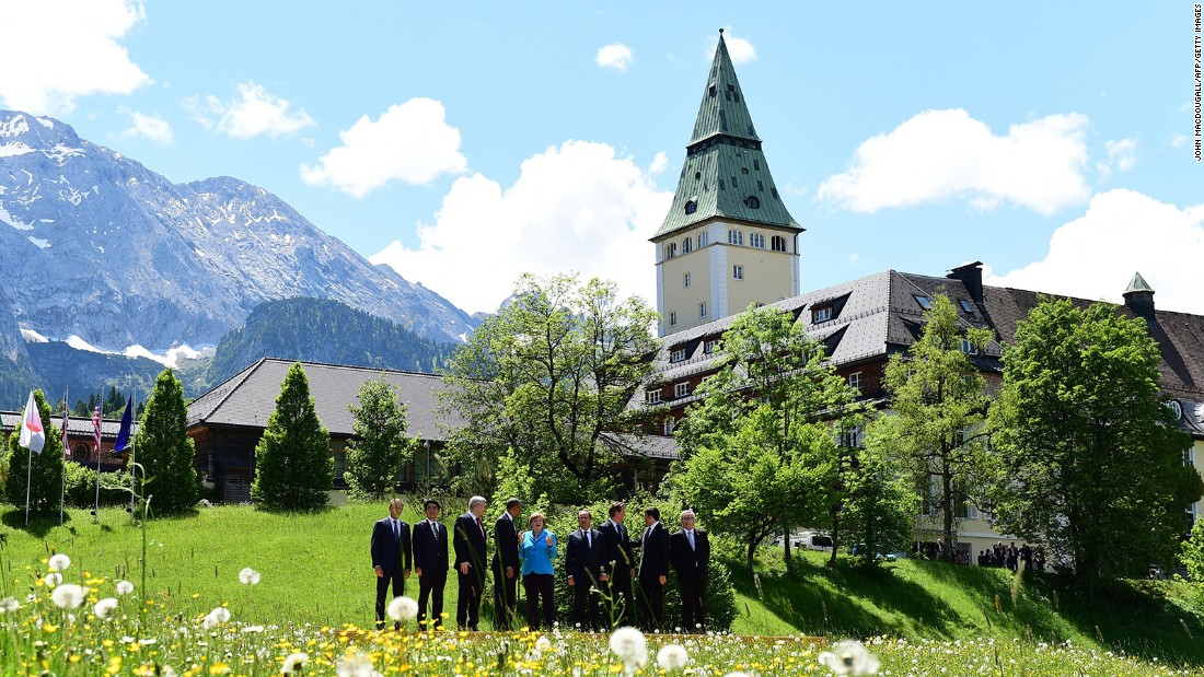 From left: European Council President Donald Tusk, Japanese Prime Minister Shinzo Abe, Canadian Prime Minister Stephen Harper, Obama, Merkel, French President Francois Hollande, British Prime Minister David Cameron, Italian Prime Minister Matteo Renzi and European Union Commission President Jean-Claude Juncker pose for a photo at Elmau Castle near Garmisch-Partenkirchen, southern Germany, on June 7.