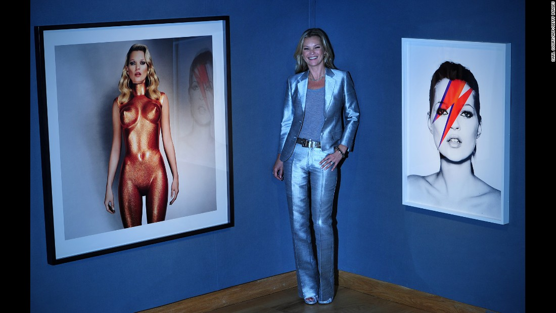"Moss poses for photographers in September 2013. Allen Jones' photograph ""Body Armour,"" seen at left, sold for $52,000. The one on the right, ""Kate 'Aladdin Sane' "" by Nick Knight, sold for more than $47,000."