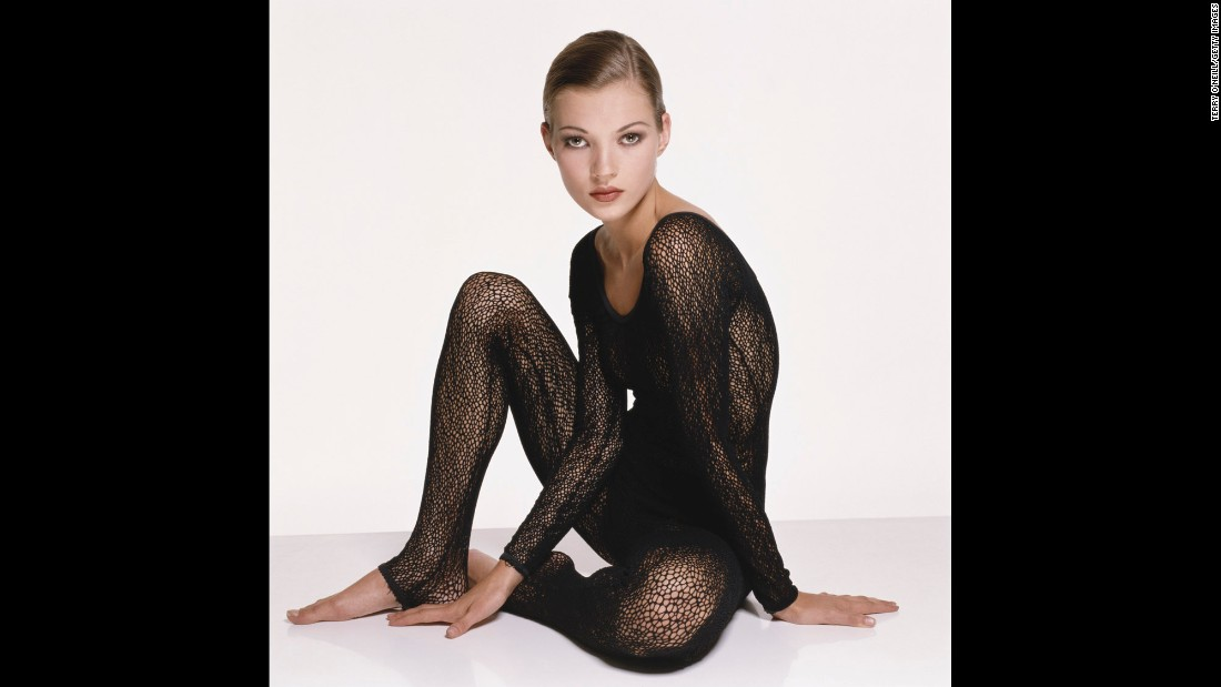 Kate Moss, wearing a knitted black body stocking, poses for a photo circa 1993.