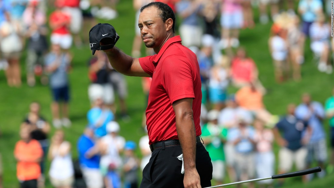 Tiger Woods acknowledges the crowd on the 18th hole at the 2015 Memorial Tournament, where he carded the worst round of his professional career while also recording his highest ever aggregate total.