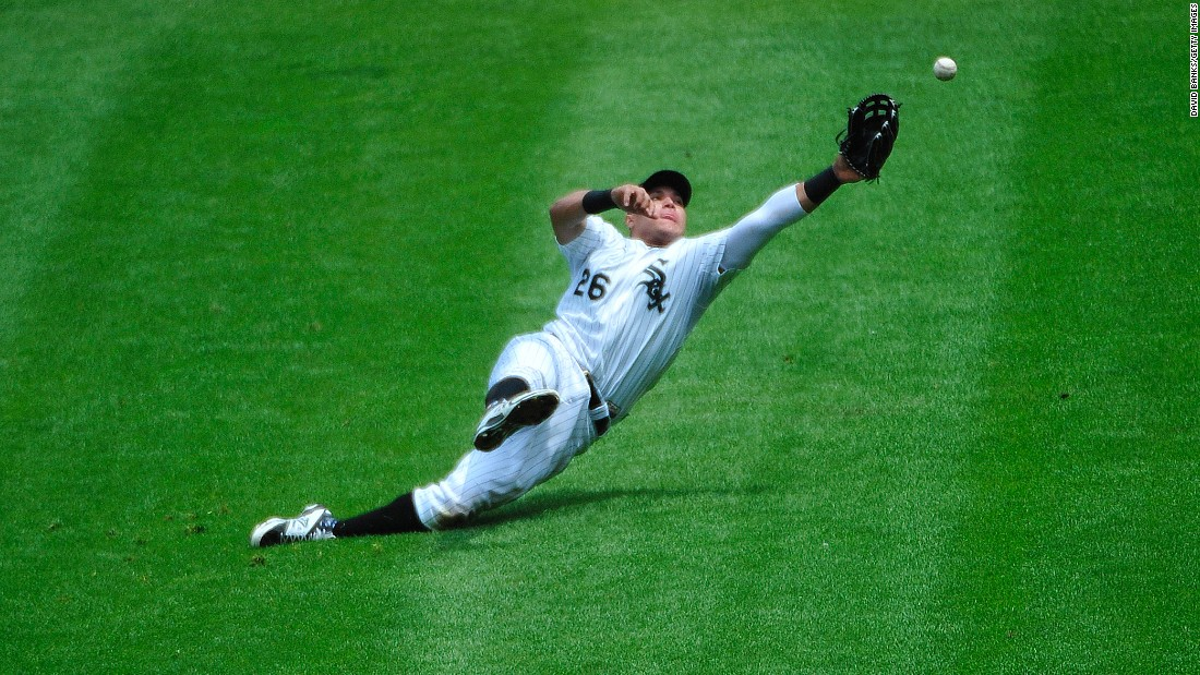 Avisail Garcia, an outfielder for the Chicago White Sox, dives for a catch on Sunday, June 7.