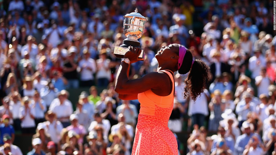 "Serena Williams holds up her trophy after <a href=""http://www.cnn.com/2015/06/06/sport/french-open-tennis-serena-williams-safarova/"" target=""_blank"">winning the French Open</a> on Saturday, June 6. Williams defeated Lucie Safarova in straight sets. This is the third French Open title of her career and her 20th Grand Slam title. Only Steffi Graf has won more major titles in the Open era (22)."