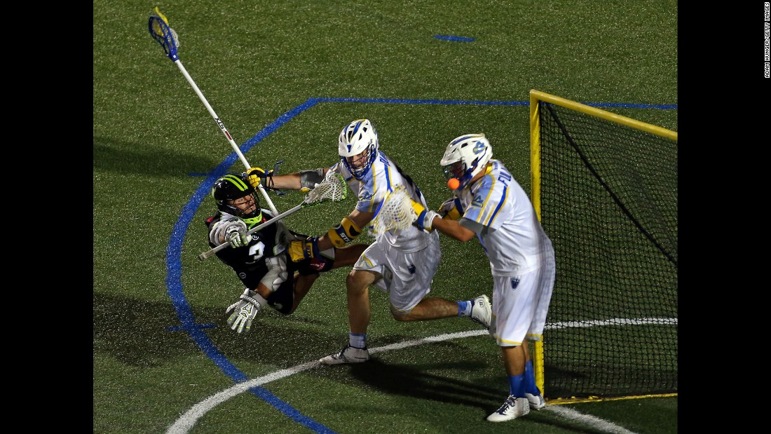 New York's Rob Pannell, left, takes a diving shot on Florida's Adam Fullerton, right, during a Major League Lacrosse game Friday, June 5, in Hempstead, New York.