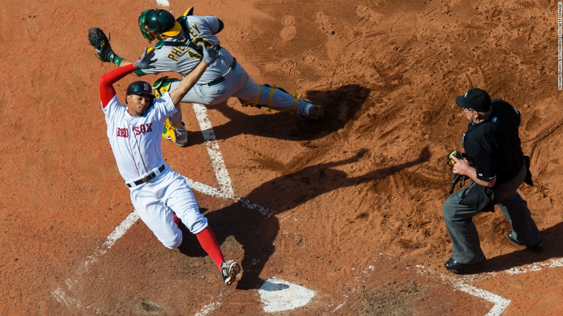 Boston's Xander Bogaerts avoids the tag of Oakland's Josh Phegley during a Major League Baseball game on Sunday, June 7.