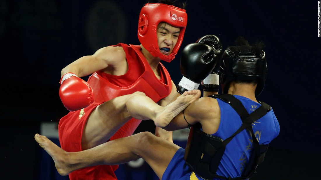 Singapore's Lee Aik Hong, left, fights Myanmar's Ko Chit Ko at the Southeast Asian Games on Saturday, June 6. Ko won the bout 2-0 and advanced to the quarterfinals of his weight class.