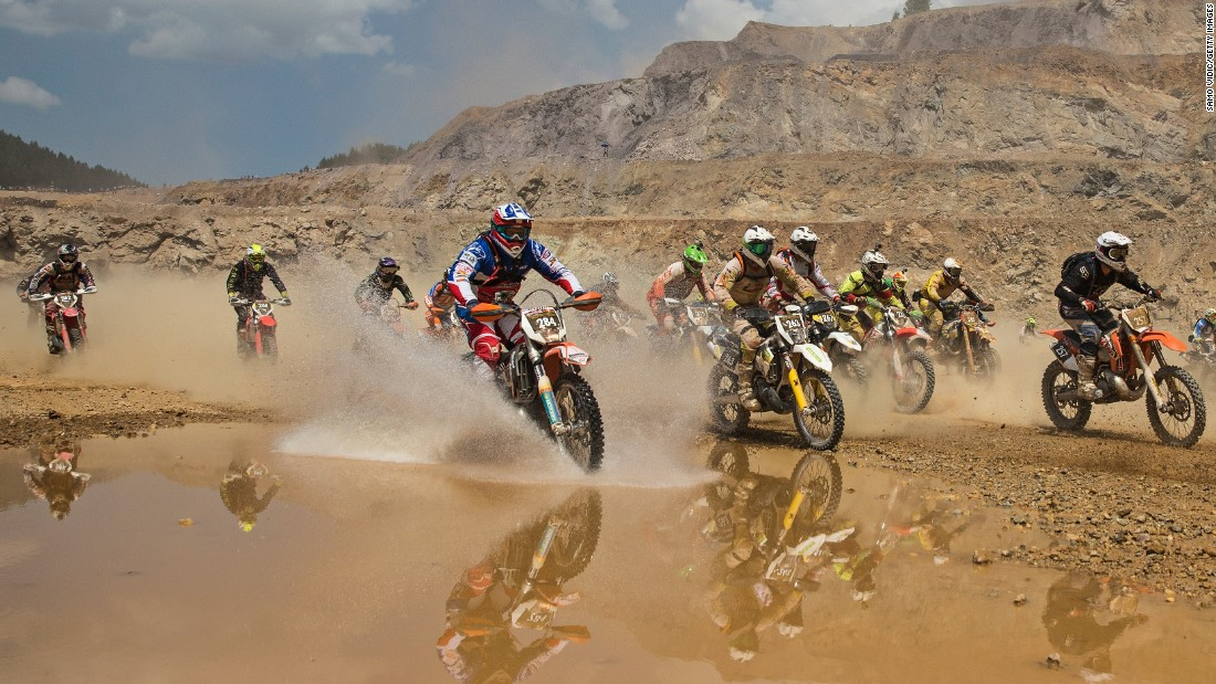 Dirt bike racers compete in the Red Bull Hare Scramble, an off-road endurance race in Austria, on Sunday, June 7.