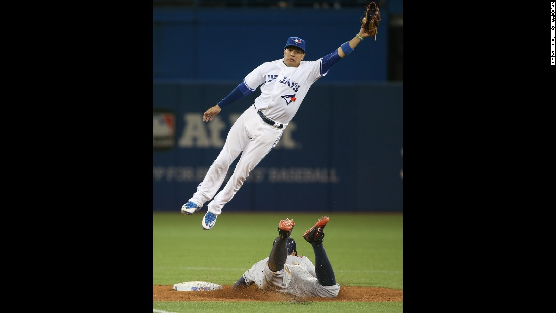 Toronto's Ryan Goins jumps for a high throw as Houston's George Springer steals second base on Friday, June 5.