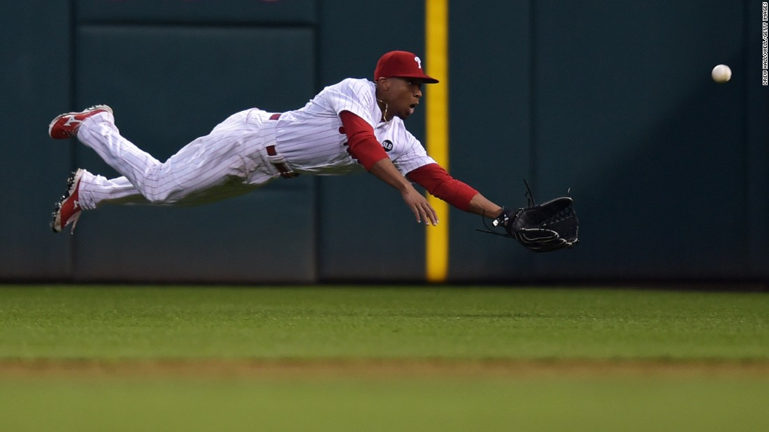 Philadelphia's Ben Revere dives for a ball during a home game against Cincinnati on Tuesday, June 2.