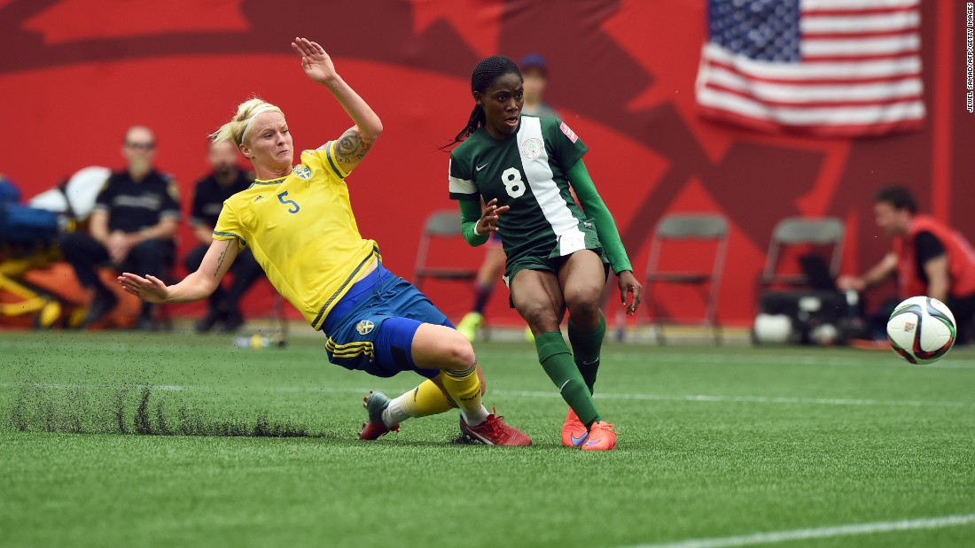 Nigeria forward Asisat Oshoala, right, scores a goal against Sweden during a Women's World Cup match June 8 in Winnipeg. The game ended in a 3-3 draw.