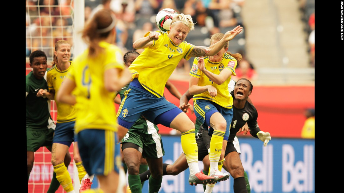 Sweden's Nilla Fischer heads the ball for her team's first goal.