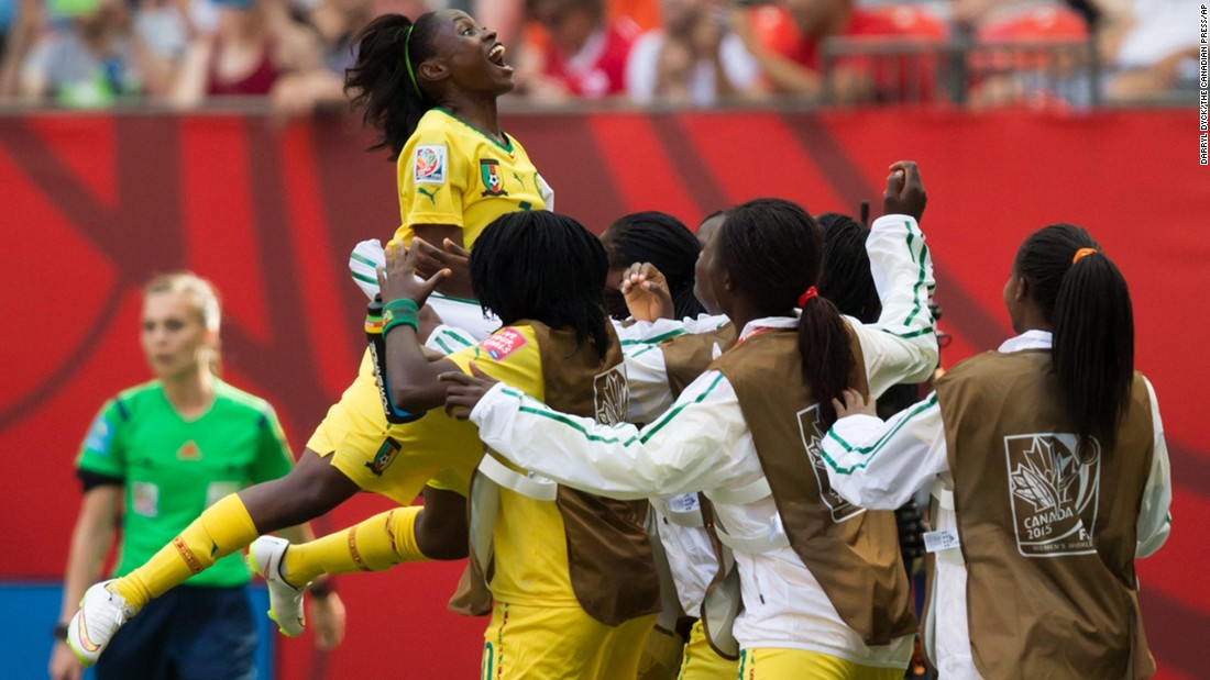 Cameroon's Gabrielle Onguene, left, leaps into the arms of her teammates on the sideline after she scored against Ecuador on June 8. Cameroon won the match 6-0.