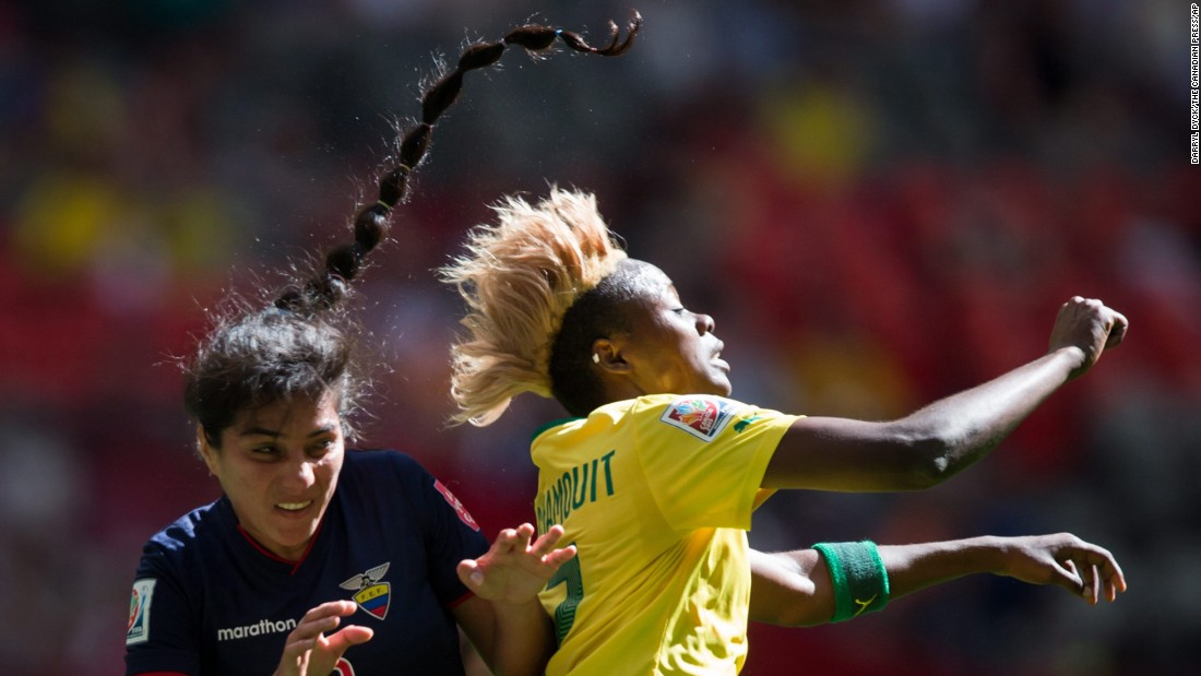 Ecuador's Nancy Aguilar, left, and Cameroon's Gaelle Enganamouit collide.