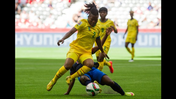 Christine Manie of Cameroon jumps to avoid the tackle of Monica Quinteros.