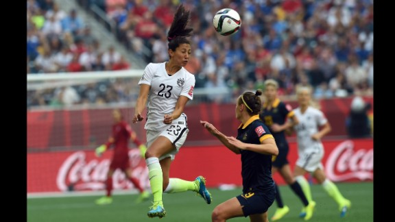 U.S. forward Christen Press heads the ball.