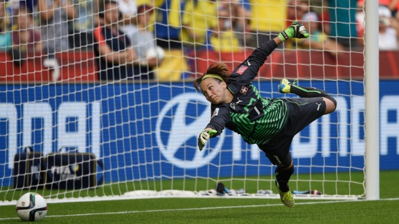 Swiss goalkeeper Gaelle Thalmann dives the right way but can