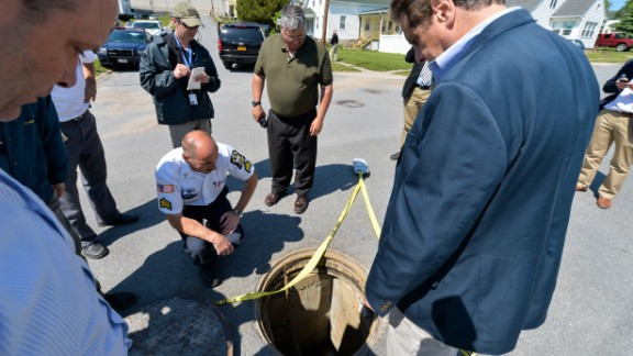 """New York Gov. Andrew Cuomo, right, is shown the manhole where <a href=""""http://www.cnn.com/2015/06/06/us/new-york-escapees/index.html"""" target=""""_blank"""">two convicted murderers escaped</a> from the Clinton Correctional Facility in Dannemora, New York, on Saturday, June 6, 2015. Police say Richard Matt, 48, and David Sweat, 34, escaped from the maximum-security prison using power tools."""
