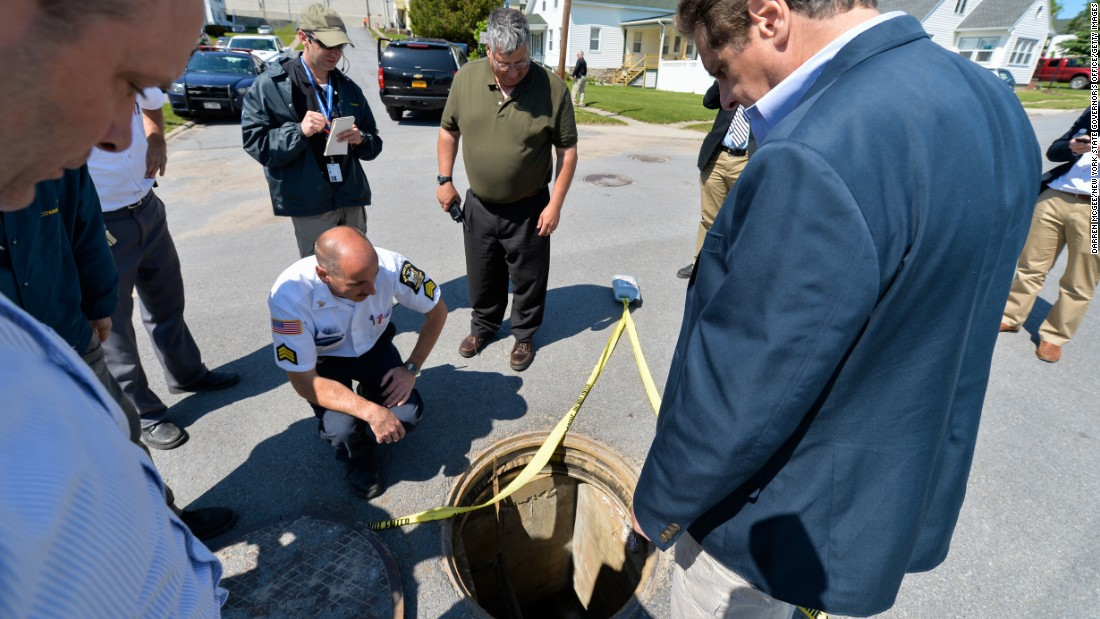 "New York Gov. Andrew Cuomo, right, is shown the manhole where <a href=""http://www.cnn.com/2015/06/06/us/new-york-escapees/index.html"" target=""_blank"">two convicted murderers escaped</a> from the Clinton Correctional Facility in Dannemora, New York, on Saturday, June 6, 2015. Police say Richard Matt, 48, and David Sweat, 34, escaped from the maximum-security prison using power tools."