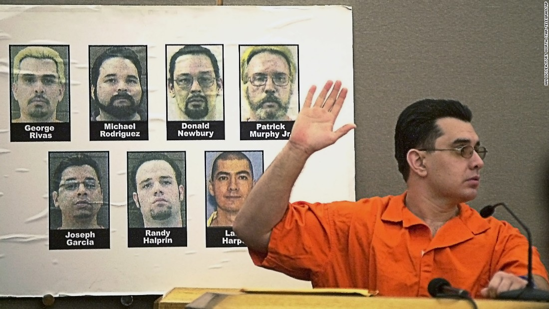 George Rivas is sworn in at a trial in Dallas in November 2003. On December 13, 2000, Rivas' gang, known as the Texas Seven, overpowered workers at a prison in Kenedy, Texas. They stole the workers' clothes, broke into the prison's armory to get guns and drove away in a prison truck. They committed several robberies and gunned down a police officer.