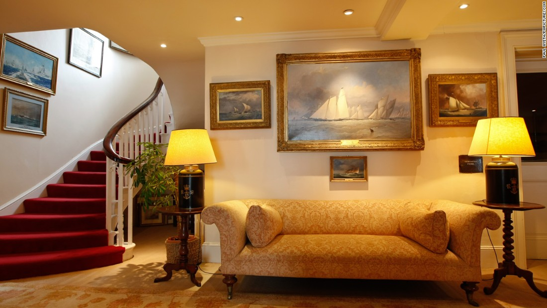 A large painting in the lounge of the Royal Yacht Squadron depicts a yacht in full sail.