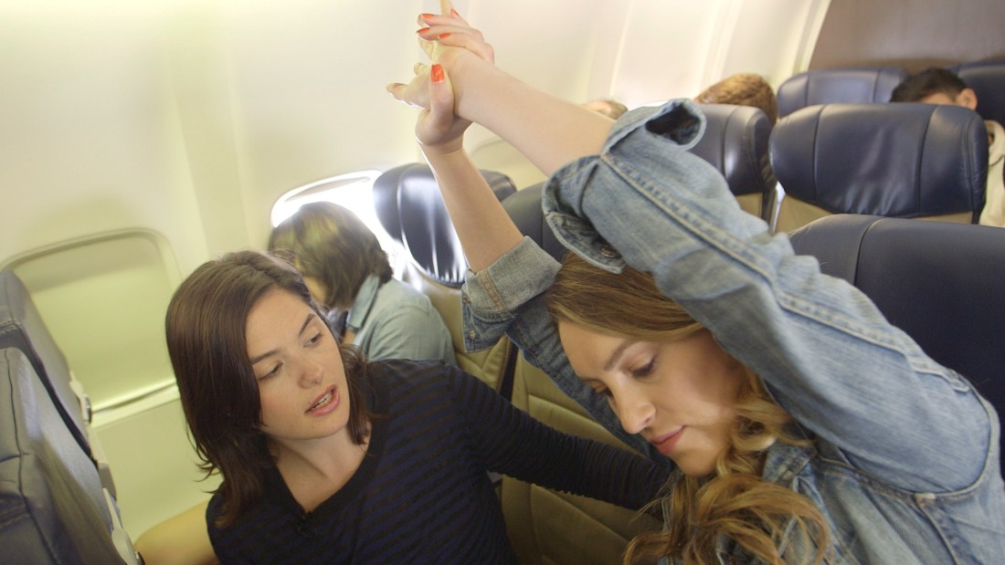 No time to do your practice while traveling? Don't worry, there's even airplane yoga as seen here.
