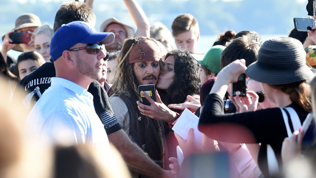 "A fan in Brisbane, Australia, takes a selfie with actor Johnny Depp, who is dressed as iconic character Jack Sparrow on Thursday, June 4. Depp was in Brisbane filming the newest ""Pirates of the Caribbean"" movie."