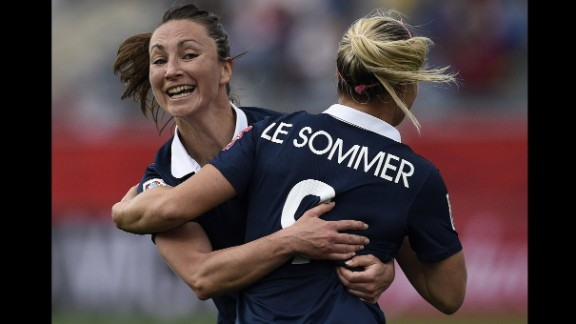 French forward Eugenie Le Sommer is congratulated by teammate Gaetane Thiney after scoring the game