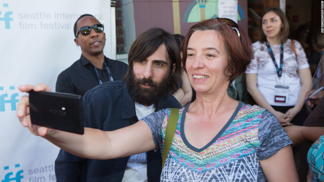 "Actor Jason Schwartzman poses with a fan in Seattle before a screening of the film ""7 Chinese Brothers"" on Saturday, June 6."