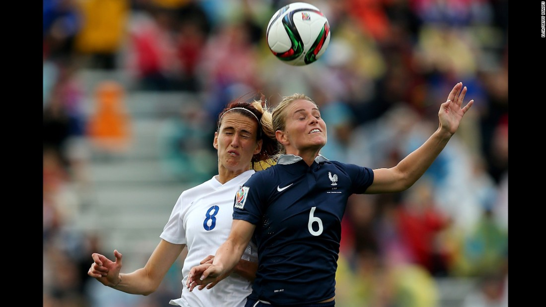 Jill Scott of England and Amandine Henry of France compete for a header.
