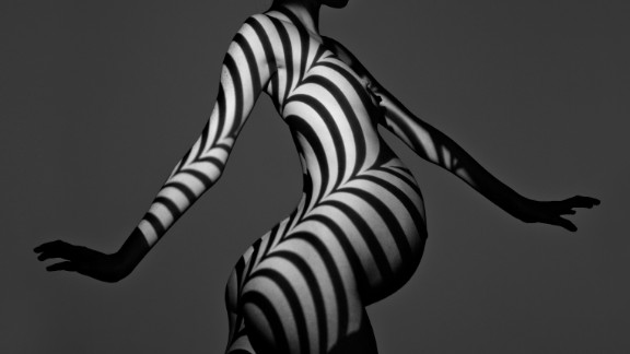 Here, Schatz experiments with light and shade against a pregnant woman's body. <br />The result is hypnotic.
