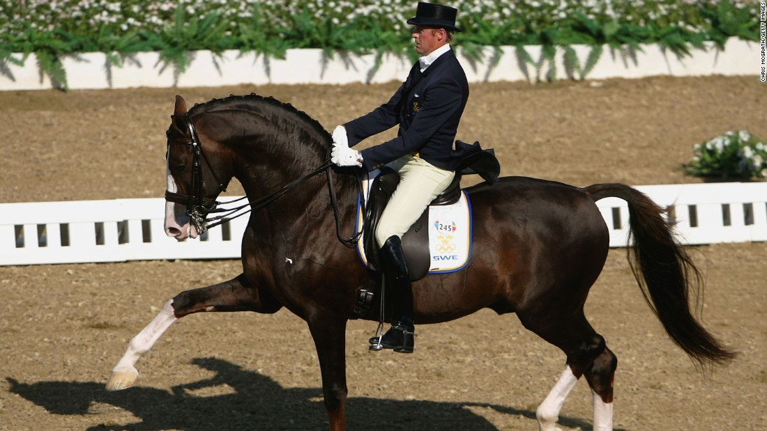 Jan Brink of Sweden wears classic attire as he competes in the individual dressage grand prix freestyle event during the Athens 2004 Summer Olympic Games.