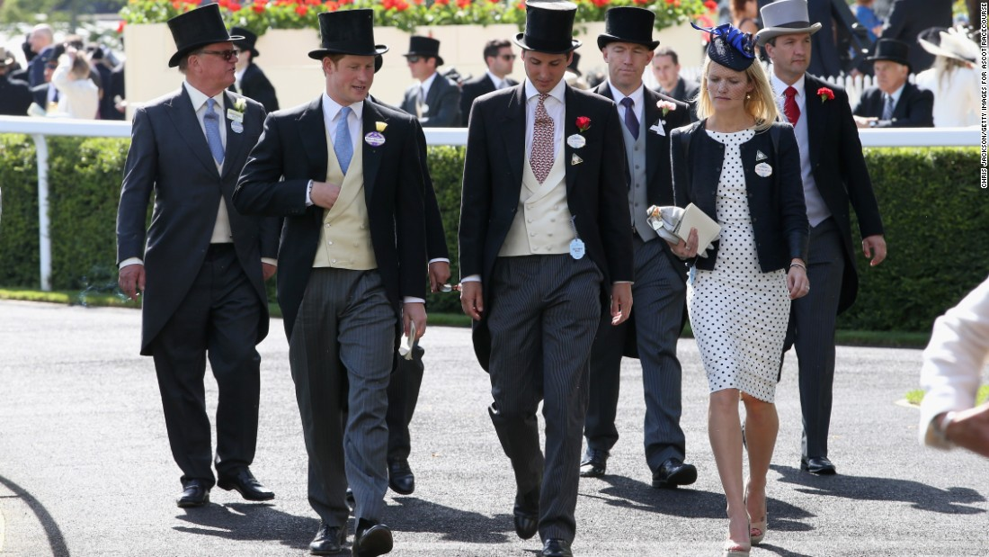 Prince Harry (second left) and Jake Warren (third left) are among a group arriving at Ascot in 2014 wearing the traditional morning suit and top hat associated with major events at the racecourse.