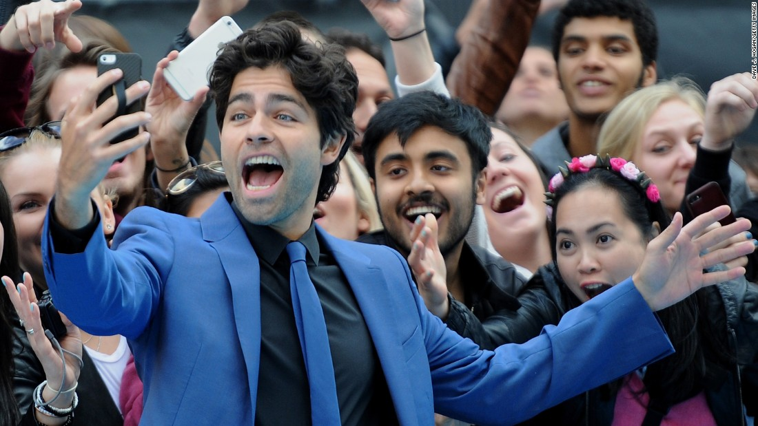 "Actor Adrian Grenier snaps a selfie in London while attending the European premiere of ""Entourage"" on Tuesday, June 9."