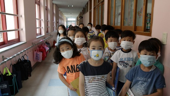 Elementary school students wear masks as a precaution against the MERS virus as they wait for a lesson to start at Midong Elementary School in Seoul, South Korea.