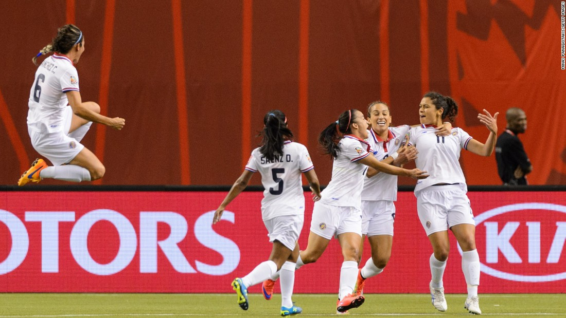 Raquel Rodriguez Cedeno, right, celebrates her goal with her Costa Rican teammates.
