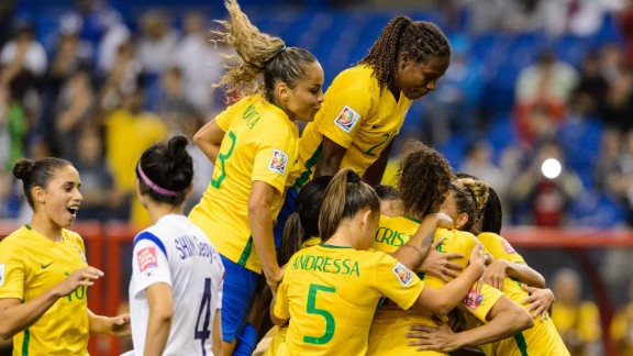 Brazilian players celebrate a goal scored by Marta during their match against South Korea on Tuesday, June 9. Brazil won the match 2-0 in Montreal.
