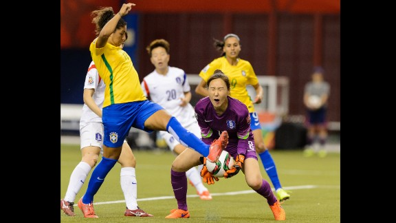South Korean hoalkeeper Kim Jung-mi makes a save near Brazil