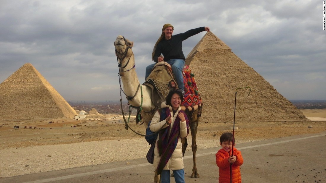 "U.S. tourist <a href=""http://ireport.cnn.com/docs/DOC-1247355"">Brian Wahl </a>couldn't resist having this photo taken at the pyramids in Giza January this year. He moved to the country with his family due to his wife's job, and has been loving the experience. ""Even though we have lived in Alexandria for half a year, there is still not a day that I don't hear someone welcoming me,"" he says."