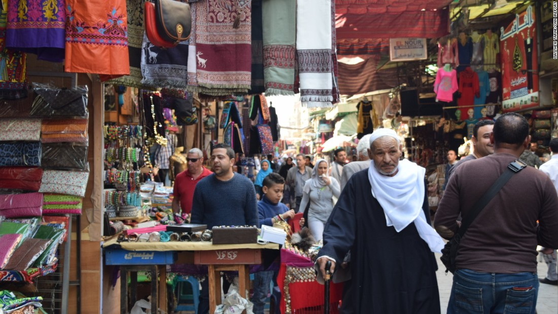 "<strong>The markets: </strong>U.S. expat <a href=""http://ireport.cnn.com/docs/DOC-1247673"">Matthew Tarney</a> enjoyed a walk through Old Cairo's Khan el-Khalili market while visiting in March. ""This picture is one of many that I took to try and capture the movement and vitality of the market street as both Egyptians and visitors shopped among the colorful booths,"" he says."