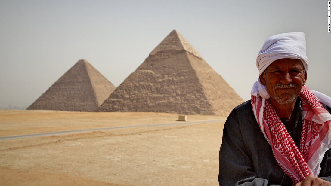"<strong>The pyramids: </strong>Portuguese tourist <a href=""http://ireport.cnn.com/docs/DOC-1247654"">Fabio Passos </a>captured this lovely image of the pyramids -- and a local enjoying the view -- in Giza, Egypt."
