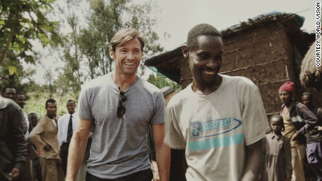 Hugh Jackman and his new found friend, Ethiopian coffee farmer Dukale, outside of  Dukale's Yirgacheffe home.
