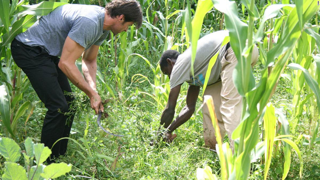Jackman, seen here planting a tree with Dukale in Ethiopia, liked the taste of Dukale's coffee so much, he wanted to market it. His company, Laughing Man Coffee, recently partnered with Keurig.