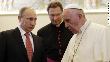 Russian President Vladimir Putin listens to Pope Francis on the occasion of a private audience at the Vatican, Wednesday, June 10, 2015. (AP Photo/Gregorio Borgia, Pool)