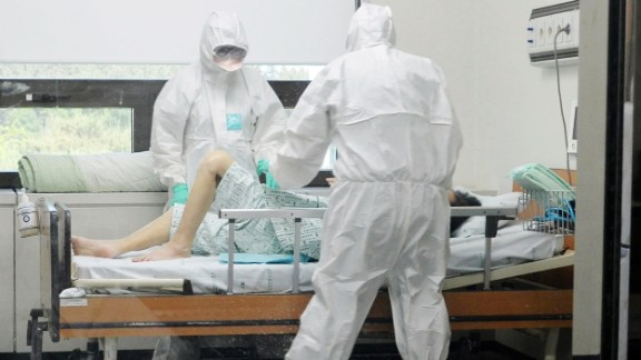 This picture taken on June 7, 2015 shows medical workers caring for a MERS patient at Konyang University Hospital in Daejeon, south of 140 km south of Seoul. South Korea recorded its sixth death and biggest single day jump in Middle East Respiratory Syndrome (MERS) infections on June 8, with 23 new cases in the largest outbreak of the potentially deadly virus outside Saudi Arabia. REPUBLIC OF KOREA OUT NO ARCHIVES RESTRICTED TO SUBSCRIPTION USE AFP PHOTO / YONHAPYONHAP/AFP/Getty Images