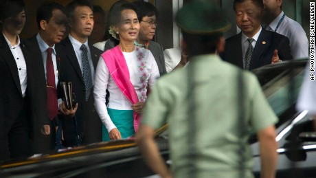 Myanmar's opposition leader Aung San Suu Kyi arrives at Beijing Capital International Airport.