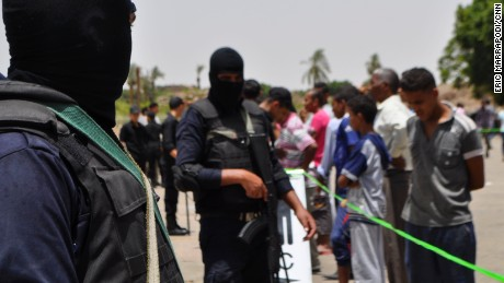 Security forces stand guard at the site of a suicide bombing, near Karnak Temple in Luxor, Egypt, Wednesday, June 10, 2015. A suicide bomber blew himself up on Wednesday just steps away from the ancient Egyptian temple in Luxor, a southern city visited by millions of tourists every year, security and health officials said. No tourists were killed or hurt in the late morning attack. (AP Photo)
