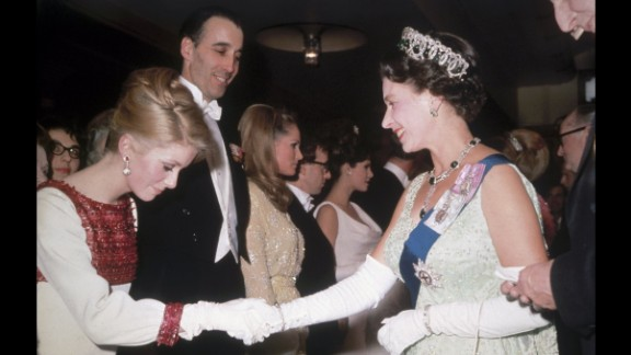 Lee, second from left, stands by as Queen Elizabeth II greets French actress Catherine Deneuve in 1966. Also present, from left, are Ursula Andress, Woody Allen and Raquel Welch. Lee was named a knight of the British Empire in 2009.