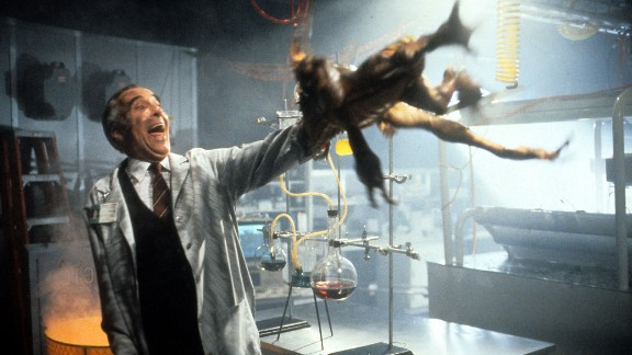"""Lee tries to throw a gremlin off his arm in the 1990 film """"Gremlins 2: The New Batch."""""""